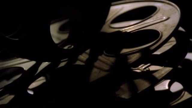 closeup of empty film reels rotating - biosalong bildbanksvideor och videomaterial från bakom kulisserna