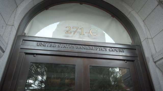 closeup of entrance signage to the united states bankruptcy court at 271 cadman plaza east in brooklyn new york. - bankruptcy stock videos & royalty-free footage