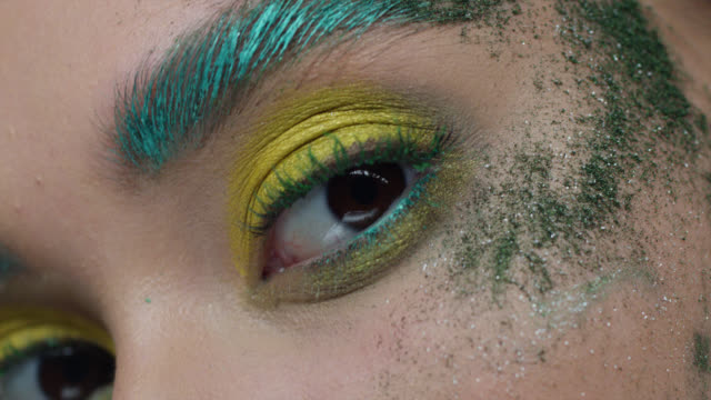close-up of fashion model's eyes in colorful stage make-up. - eyeshadow stock videos & royalty-free footage