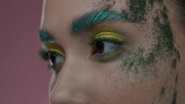 close-up of fashion model's parts of face in colorful stage make-up. fashion video. - lip liner stock videos & royalty-free footage