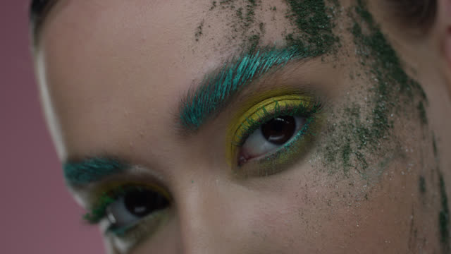 close-up of fashion model'‎s parts of face in colorful stage‎ make-up. fashion video. - model stock videos & royalty-free footage