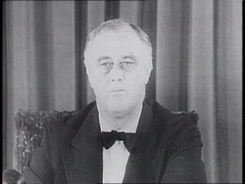closeup of fdr smiling in chair / speaks from podium on south porch of the white house / press and newsreel cameramen lined up in fdr's home for a... - civilian conservation corps stock-videos und b-roll-filmmaterial
