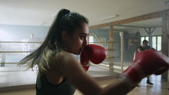 Close-up, of female boxer throwing a punch