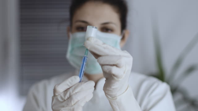 close-up of female doctor preparing a syringe,slow motion stock video - anesthetic stock videos & royalty-free footage