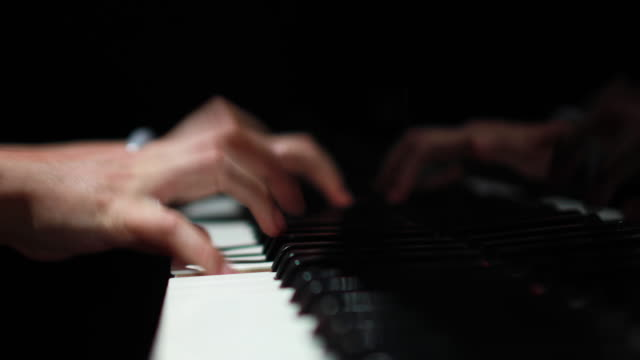 4k close-up of female hands playing piano - piano stock videos and b-roll footage