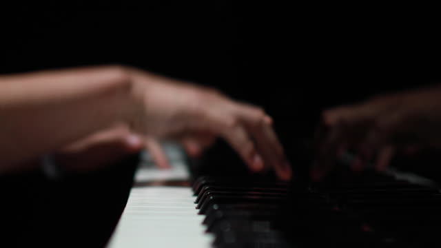 4k close-up of female hands playing piano - human finger stock videos and b-roll footage