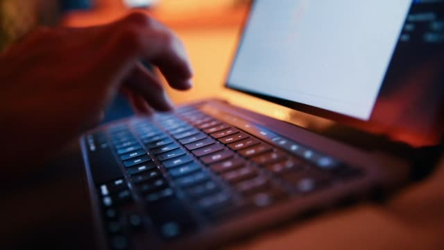 close-up of female hands typing on laptop keyboard - illuminated stock videos & royalty-free footage