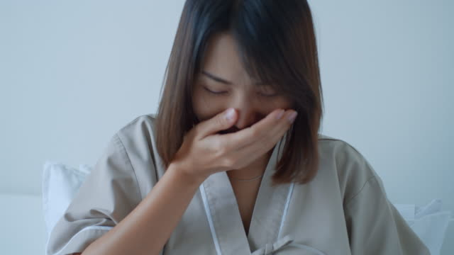close-up of female patient heavy cough symptoms until bleeding,slow motion - one young woman only stock videos & royalty-free footage
