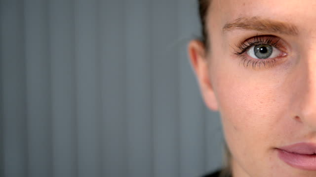 close-up of female's cross section face - blue eyes stock videos and b-roll footage