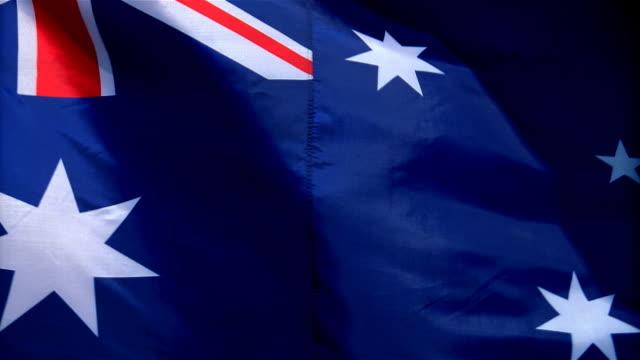 Closeup of flag of Australia waving in wind