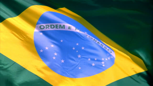 Closeup of flag of Brazil waving in wind