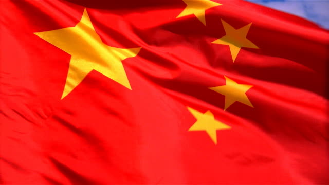 Closeup of flag of China waving in wind