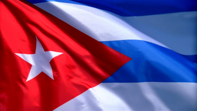closeup of flag of cuba waving in wind - formato video mpeg video stock e b–roll