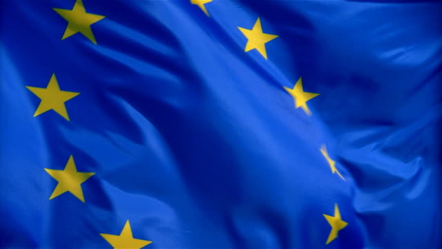closeup of flag of european union waving in wind - formato video mpeg video stock e b–roll
