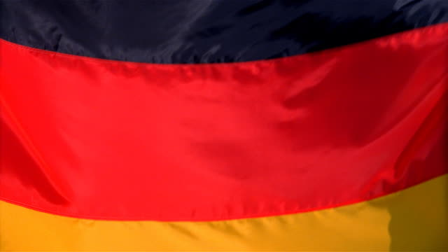 Closeup of flag of Germany waving in wind