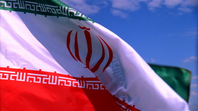 Closeup of flag of Iran waving in wind