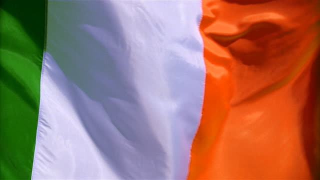 Closeup of flag of Ireland waving in wind