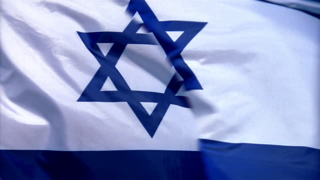 closeup of flag of israel waving in wind - formato video mpeg video stock e b–roll