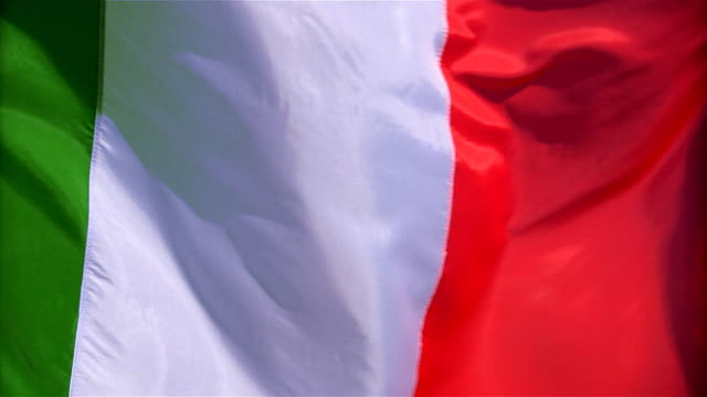 closeup of flag of italy waving in wind - formato video mpeg video stock e b–roll