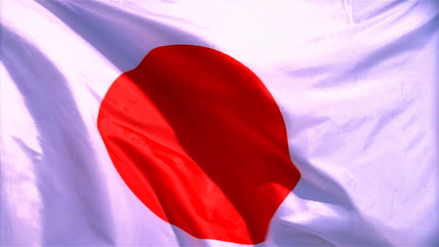 Closeup of flag of Japan waving in wind