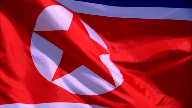 Closeup of flag of North Korea waving in wind