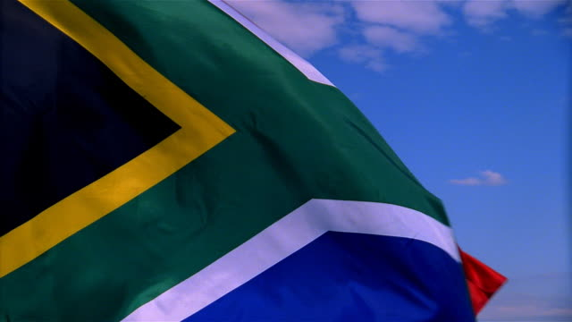 closeup of flag of the south africa waving in wind - formato video mpeg video stock e b–roll