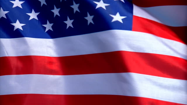 closeup of flag of the united states waving in wind - formato video mpeg video stock e b–roll