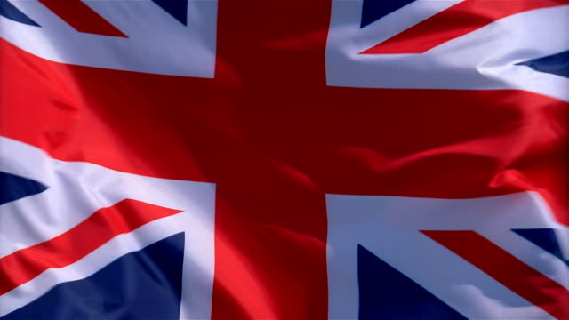 Closeup of flag of United Kingdom waving in wind
