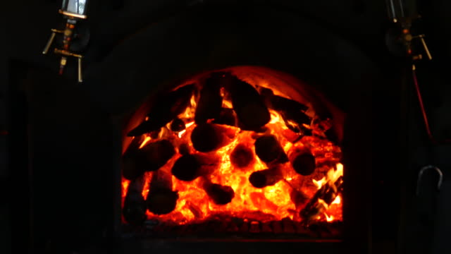 closeup of  flame and embers burning in a wood-fired oven - hearth oven stock videos & royalty-free footage