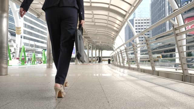 close-up of foot businesswoman walking to work - low angle view stock videos & royalty-free footage