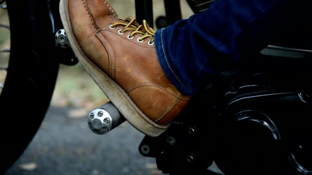 close-up of foot woman in boots on a motorcycle. - tire vehicle part stock videos and b-roll footage