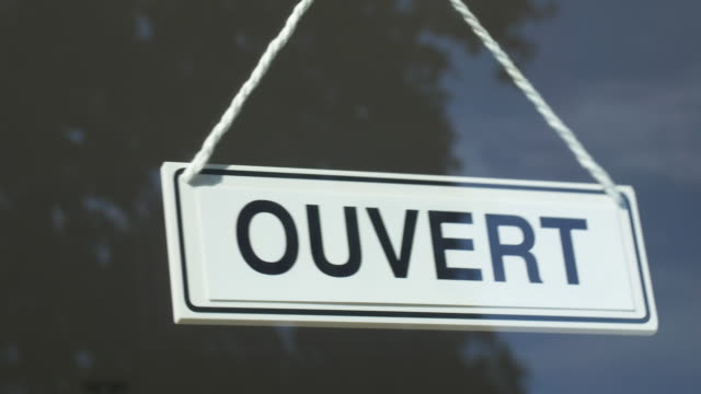 close-up of french language open/closed sign in store window.store opening. - store sign stock videos & royalty-free footage