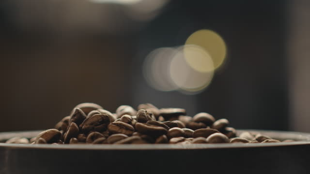 close-up of fresh roasted coffee beans - artisanal food and drink stock videos & royalty-free footage