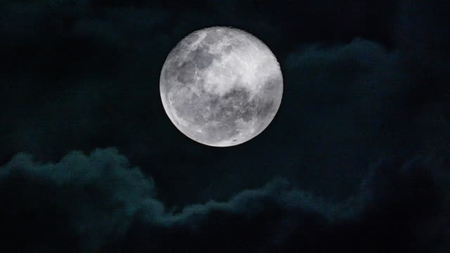 close-up of full moon at night taken with 600 mm telephoto lens - telephoto lens stock videos & royalty-free footage