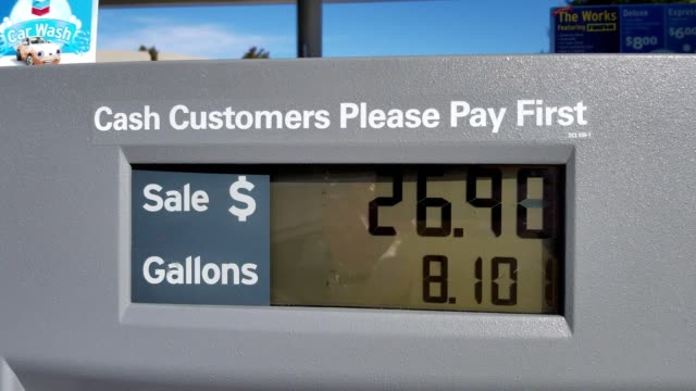 Closeup of gas pump showing increasing cost and gallons pumped at a Chevron gas station in Palo Alto California November 14 2017