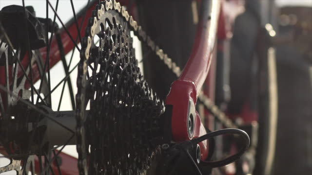 Closeup of gears sprocket chain and chain ring on a mountain bike. - Slow Motion