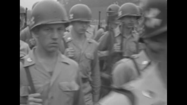 stockvideo's en b-roll-footage met closeup of gen douglas macarthur saluting / american soldiers marching with rifles / american military policeman with white helmet gloves and lanyard... - douglas macarthur