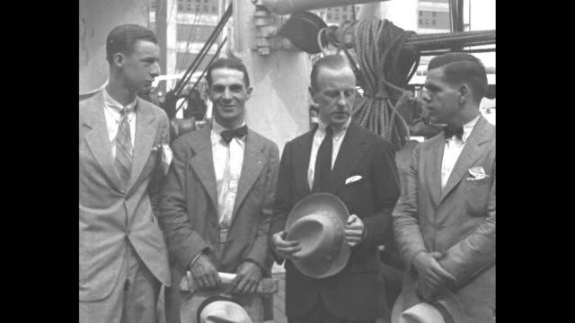 closeup of george miller dyott taking off his straw hat he stands with three other unidentified men he will travel on the river of doubt / note exact... - straw hat stock videos and b-roll footage