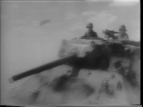 vidéos et rushes de closeup of george s patton in uniform / aerial view of african desert / patton looking through binoculars / panning view of tank driving on dusty... - général grade militaire