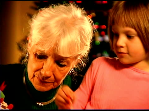 close-up of girl and grandmother  - see other clips from this shoot 1407 stock videos and b-roll footage