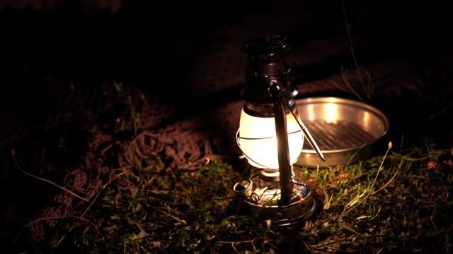 close-up of glowing lantern on field at night - lantern stock videos & royalty-free footage