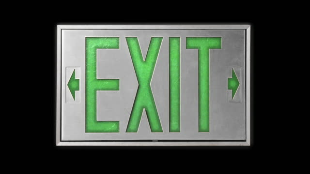 close-up of green exit sign on black background - blinking arrow stock videos & royalty-free footage
