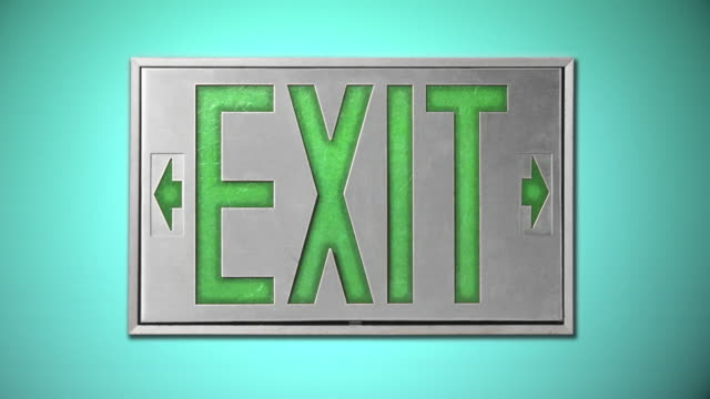 close-up of green exit sign on blue background - blinking arrow stock videos & royalty-free footage
