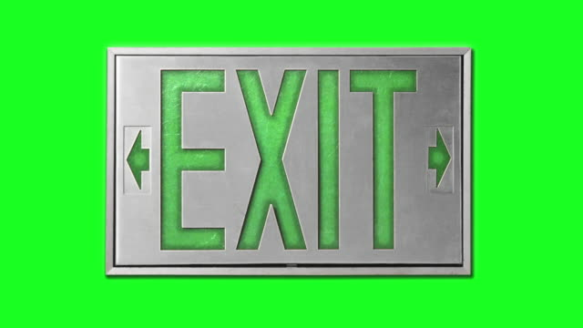close-up of green exit sign on chroma key background - blinking arrow stock videos & royalty-free footage