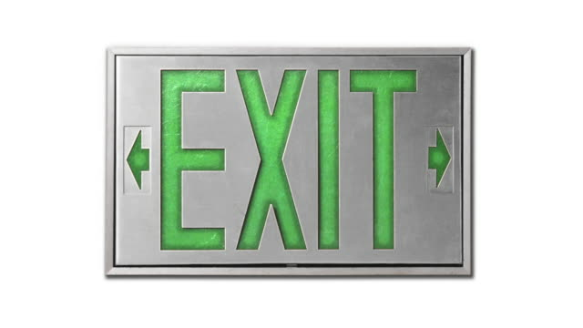 close-up of green exit sign on white background - blinking arrow stock videos & royalty-free footage