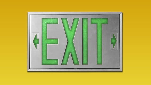 close-up of green exit sign on yellow background - blinking arrow stock videos & royalty-free footage