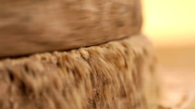 close-up of grind stone grinding spices - spice stock videos and b-roll footage