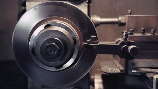 closeup of grinding disc brake machine working for grinding fixing brake system in garage workshop. closeup shot with slow motion. - brake stock videos & royalty-free footage