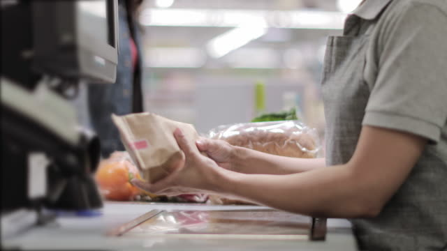 closeup of groceries being scanned at checkout - shop assistant stock videos & royalty-free footage