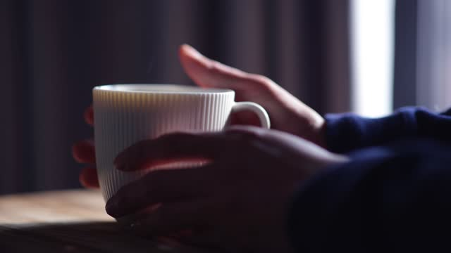 close-up of hand holding hot coffee cup - mug stock videos & royalty-free footage